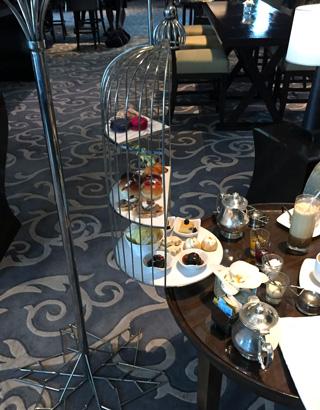 Afternoon tea at St. Regis Bangkok served in a birdcage