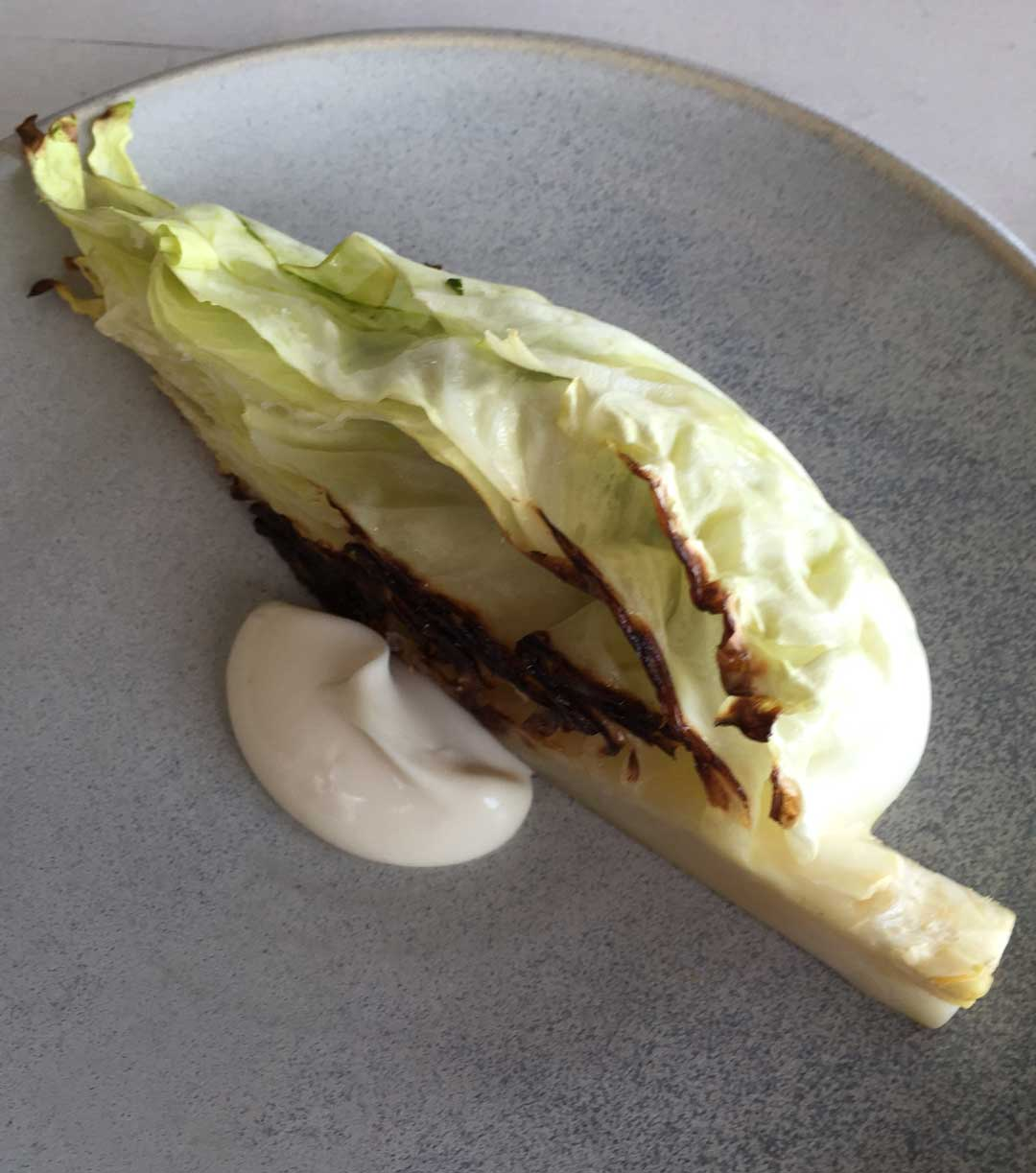 Kadeau Bornholm dish: grilled pointed cabbage stuffed with oysters and parsley