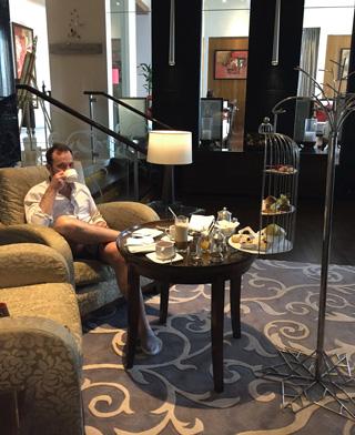the author enjoying his coffee at the Drawing Room at St. Regis Bangkok