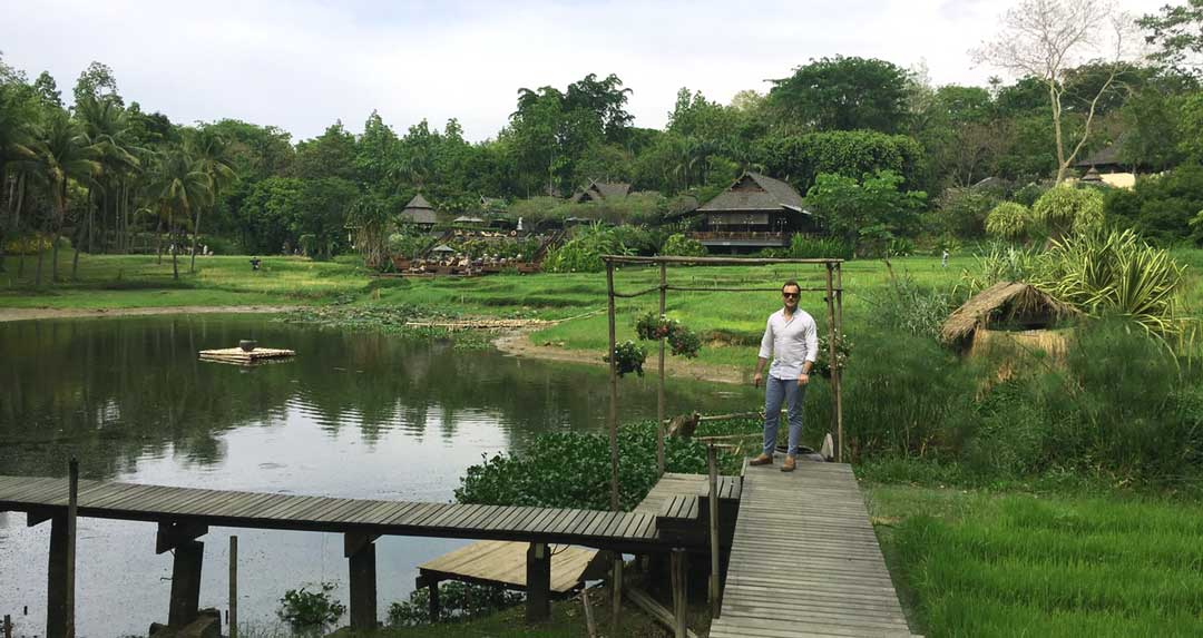 standing among the lake and rice paddies four seasons Chiang Mai